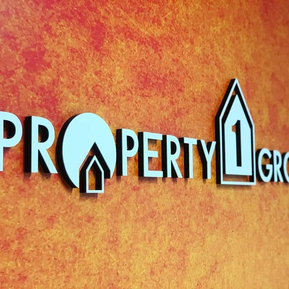 Property 1 group logo on wall